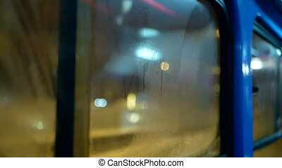 Night transport moving liight - Rain water drops on bus...