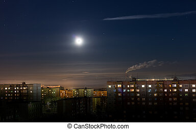 Night urban landscape with a full moon