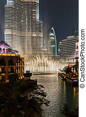 Night view Dancing fountains downtown and in a man-made lake in