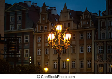 Night view of a burning lantern in the Old Town of Wroclaw. Poland