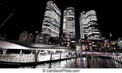 Night view of Barangaroo Skyscrapers from a moving boat, Sydney.