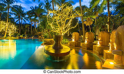 night view of beautiful swimming pool in tropical resort , Phuket, Thailand