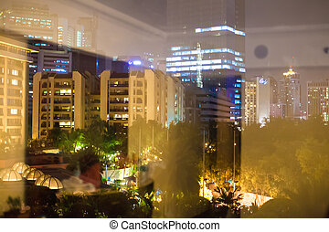 Night view of big city outside the window