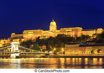 Night view of Chain bridge and royal palace in Budapest,...