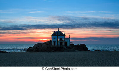 Night view of Chapel Senhor da Pedra at Miramar Beach, Porto, Portugal.