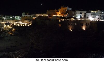 Night view of cliff and town of Polignano a Mare, Italy -...