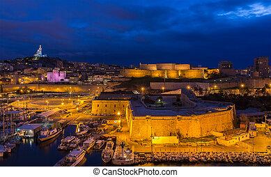 Night view of Fort St. Nicolas and Notre-Dame-de-la-Garde in...