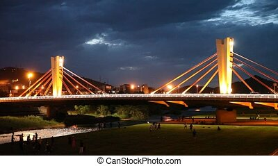 Modern impressive design of cable-stayed bridge of Can Peixauet over Besos connecting Barcelona with Santa Coloma de Gramanet at night, Spain