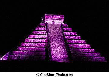 Night view of Kukulkan pyramid in ancient Mayan city Chichen...