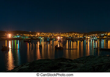 A night view of Luderitz as seen from Shark Island. Boats are visible