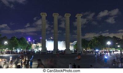 Night view of Magic Fountain light show timelapse hyperlapse witih column Barcelona, Catalonia, Spain.