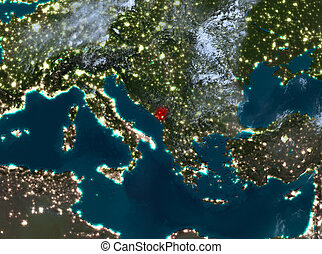 Night view of Montenegro - Country of Montenegro in red on...