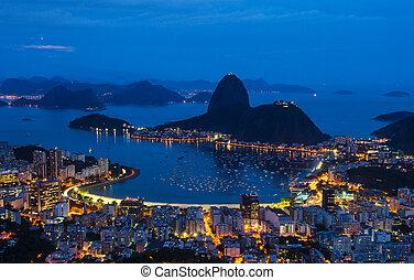 Night view of mountain Sugar Loaf and Botafogo in Rio de Janeiro