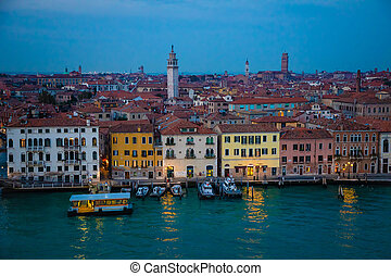 Night view of old houses on Grand Canal in Venice, Italy