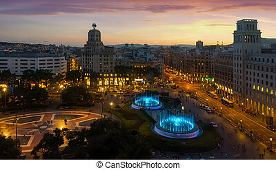 Night view of magic illuminated fountains in Plaza Catalunya in Barcelona