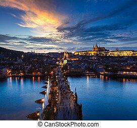 Night aerial view of Prague castle and Charles Bridge over Vltava river in Prague, Czech Republic. Prague, Czech Republic