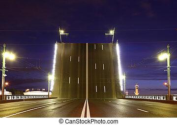 Night view of raised bridge in St.Petersburg, Russia. Palace drawbridge next to pointer of Vassilievski island.