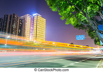 night view of road with modern building
