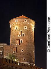 night view of sandomierska tower on wawel royal castle in cracow in poland