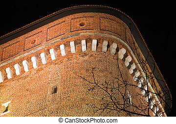 night view of senatoska tower on wawel royal castle in cracow in poland