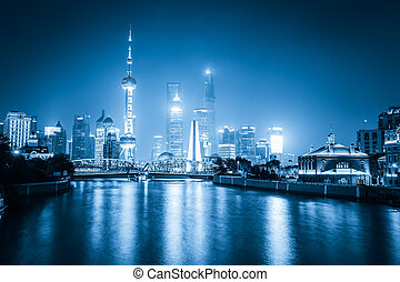 night view of shanghai with blue tone
