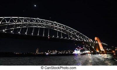 Night view of Sydney Harbour Bridge, Australia. Slow motion.