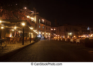 Night view of the cafes and restaurants of the old harbor town of Kyrenia (Girne) in Northern Cyprus.
