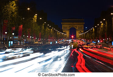 Night view of the Champs-Elysees and the Arc de Triomphe in...