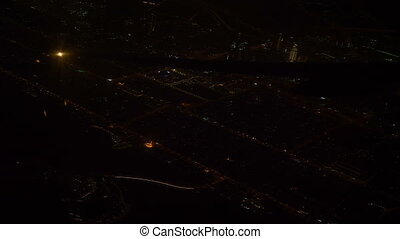 Night view of the city from an airplane. Abstract...