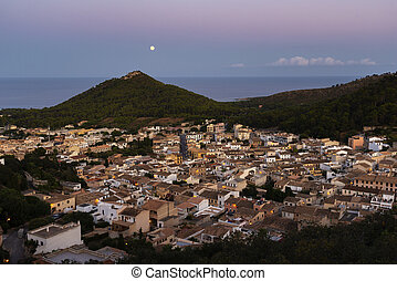 night view of the city of Capdepera from the Castle on the hills towards the sea and full moon