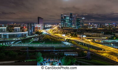 Night view of the city traffic timelapse and Building of Moscow International Business Center Moscow-City