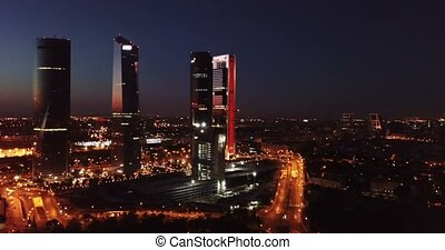 Night view of the four towers (Cuatro Torres) of the ...