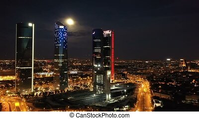 Night view of the four towers of the business district in ...