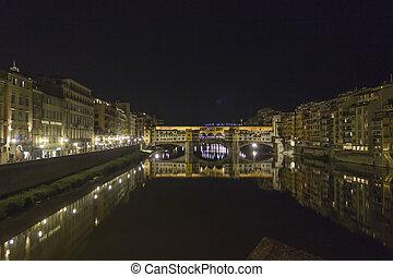 Night view of the historic Ponte Vecchio bridge