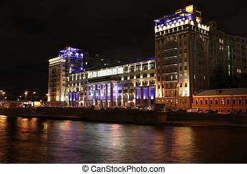 Night view of The House on the Embankment (Estrade Theater) located in the Bersenevka neighborhood of the island opposite the Moscow Kremlin, Russia
