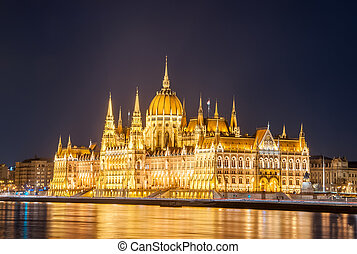 Night view of the Hungarian Parliament Building on the bank of the Danube in Budapest