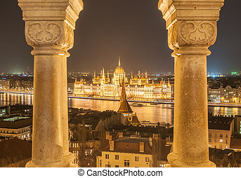 Night view of the Hungarian Parliament Building on the bank of the Danube in Budapest, Hungary