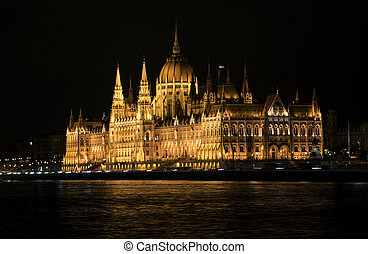 Night view of the Hungarian Parliament in Budapest, Hungary.