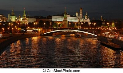 Night view of the Kremlin, Big Stone Bridge, Moscow River with boats and Kremlin's Embankment in the summer, 4k.