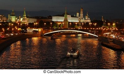 Night view of the Kremlin, Bolshoy Kamenny Bridge, Moscow River with boats and Kremlin's Embankment in the summer, 4k.