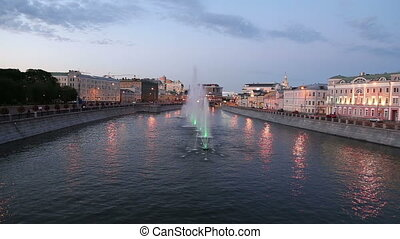 Night view on the drain channel and fountains near the...