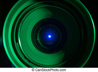 Conceptual visualization of night vision technology: low key photograph of back lit camera lens