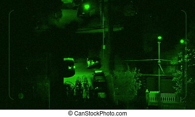 Night Vision Tracking Car Driving Near Apartments -...