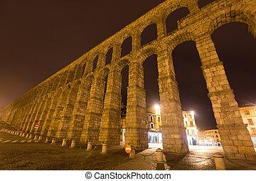 Night wide angle shot of Roman Aqueduct. Segovia