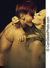 Night wish - Sexy lady in latex and redhead man over dark...