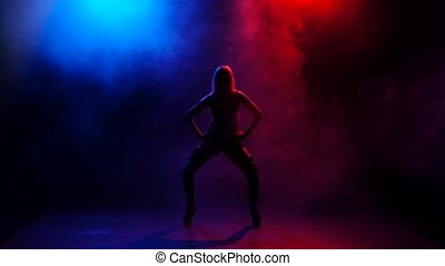 Nightclub sexy girl dancer performing on stage in bright lights