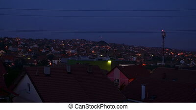 Nightfall Over a Town - Time lapse in a suburban area during...