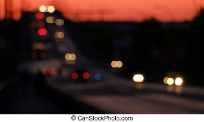 Night illuminated cityscape view with flow of defocused...