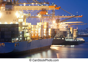 Nightly harbor activity - Two container ships being unloaded...