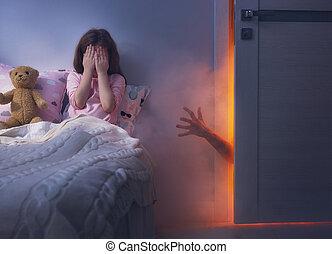 Nightmare for children. Little child girl is afraid of...